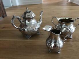 Tea pot set silver colour