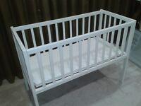 White wooden crib and mattress