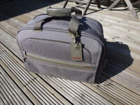 Tumi grey/silver carry-on bag