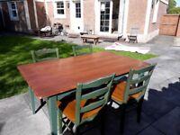 Heavy solid wood dining table and 4 chairs