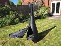 Large black metal chiminea. Stylish modern design.