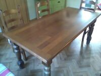 Traditionally styled oak dining table - seats up to eight