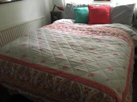 Pink and white throw with cushions