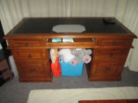 Large solid barristers desk with leather black top and 6 drawers cost new £1200 in great condition.