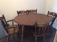 Solid wood extendable table and 5 chairs for sale