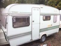 Caravan has Elddis tornado 13ft 3/4berth