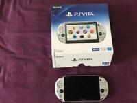 Silver PlayStation Vita with 16GB and 8GB memory cards.