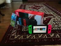 Pristine Nintendo switch with 5 games and 2 years insurance