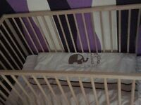 Baby's cot like new slept in once mattress is spotless
