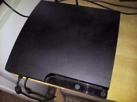 PlayStation 3 + 2 wireless controllers ( with 2 charging cables) + 9 games