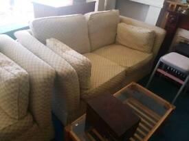 A pair of modern cream sofas