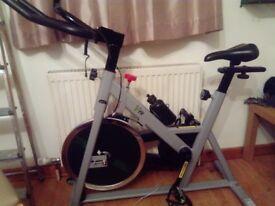 Spinning bike for sale hardly used sold as seen comes with free dvd.
