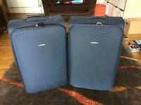 2 large Blue Tripp suitcases