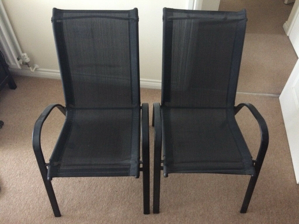 Two black mesh stackable garden chairs never used sicily chairs bought from argos