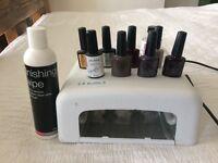 Gel nail kit lamp and polishes