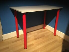 Table, white with red legs suitable for playroom