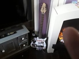 Electric guitar with amp and protective bag