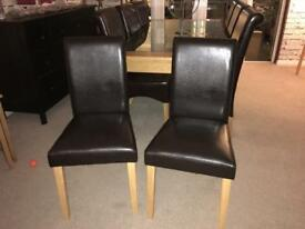 2 Faux leather dark brown chairs