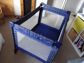 Mothercare travel cot in good condition, one small whole in side fabric