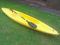 Sea kayak and paddle