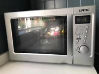 Grey Microwave in excellent good condition £15