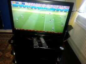XENIUS TV.2 remote controls.black glass stand in excellent condition