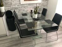 Glass dining table and chairs..