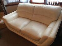 2 x white leather sofas