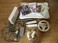Nintendo Wii (with 2 controllers + 1 steering wheel + 1 Wii Fit board + 4 games)