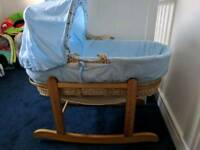 Blue moses basket with rocking stand