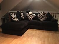 Corner sofa with selection of cushions