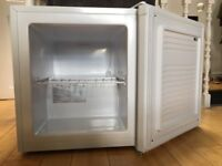 Brand new white table top/mini freezer, only used for 2 days. Perfect condition. 51x44x49cm (HxWx D)