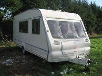 bailey 470 2000 4 berth light weight caravan with full awning in vgc