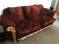 2 gorgeous sofas for £100 red, orange and wooden detail (1x 2 seater + 1x 3 seater)