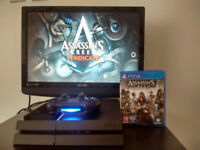 PS4 console with wireless controller and Assassin Creed Syndicate
