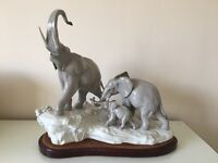 LLADRO ELEPHANT FAMILY in perfect condition with rare bespoke wooden and velvet plinth