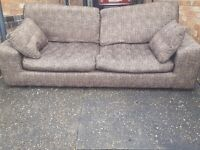 Comfy brown fabric 3 seater sofa. Good used condition. Can deliver