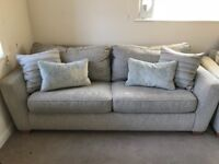 DFS large deluxe sofa bed and cuddled chair in 'pearl' colour. Only a year old.
