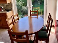 Solid Oak kitchen or dining table and 6 chairs