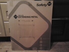 Safety first metal extending child safety gate still in box unopened box