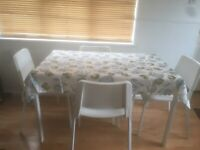 Table IKEA Melltorp and 4 chairs practically new