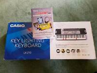 CASIO light up keyboard with stand & keyboard starter pack
