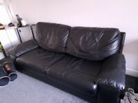 Black leather sofabed and arm chair
