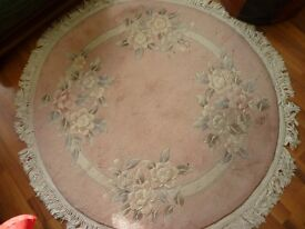 quality round pink floral rug,120 cms round,cost me £199,only £19.collect from stanmore . middlesex.