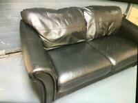 Black leather sofa two/three seater ****£60****