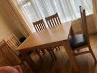 Solid wood dining room table and chairs less than half price!