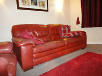 Dark red leather 3 piece suite, immaculate condition.