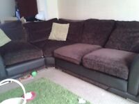 dark browm leatherette and fabric corner settee. Aprox 2 years old