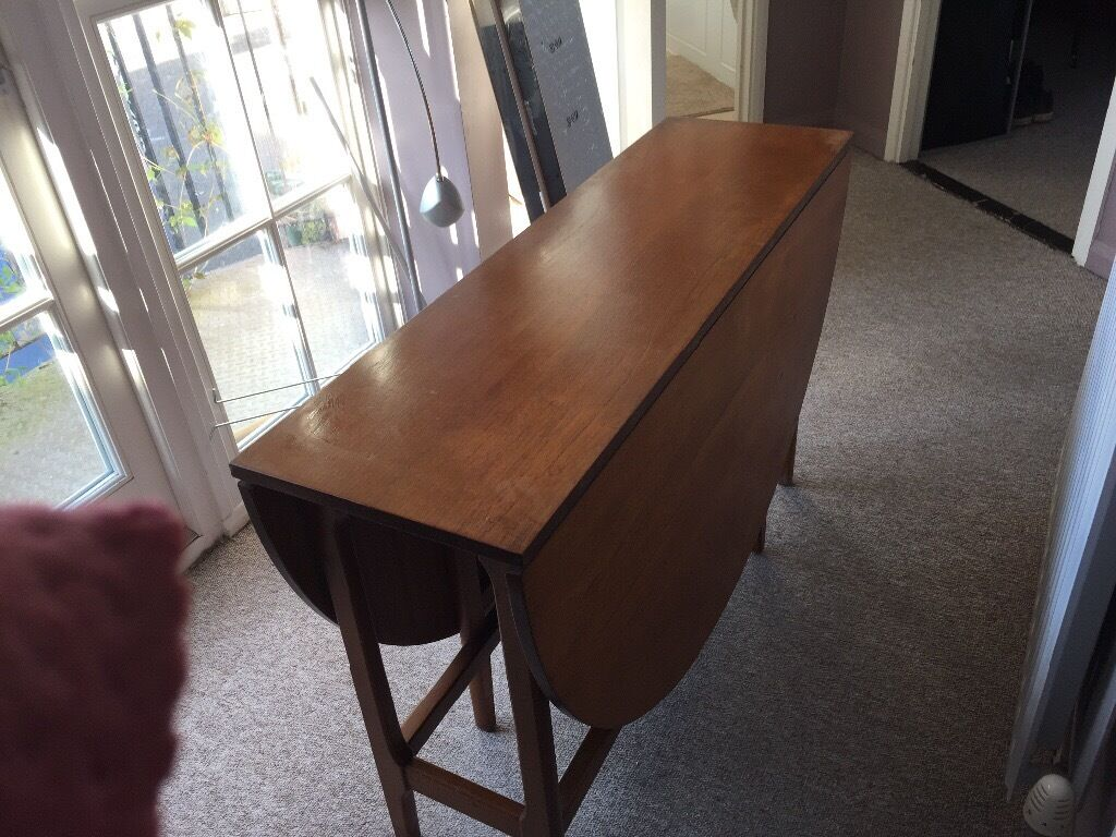 Solid wooden dining table oval fold out in Cambridge