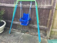 Folding Baby or Toddler swing with Safety Seat with Harness. Indoor or Outdoor use. Good condition.